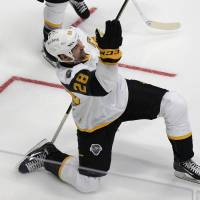 Pacific Division forward John Scott celebrates after scoring during the NHL All-Star semifinal round on Sunday. | AP
