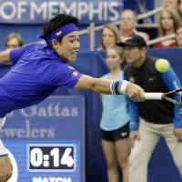 Kei Nishikori plays a shot during his match against Taylor Fritz in the Memphis Open final on Sunday. | AP