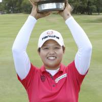 Harukyo Nomura lifts the Women's Australian Open trophy on Sunday. | KYODO