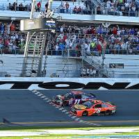 Denny Hamlin (top) beats Martin Truex Jr. to the finish line to win the Daytona 500 on Sunday. | USA TODAY/REUTERS