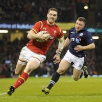 Wales winger George North (left) crosses the line to score a try in Saturday's 27-23 win over Scotland at the Principality Stadium in Cardiff. | REUTERS