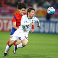 Japan's Takuma Asano chases the ball ahead of South Korea's Yeon Jeimin in Saturday night's Asian U-23 final. | REUTERS