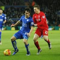 Leicester City striker Shinji Okazaki (left) holds off Liverpool's Lucas Leiva during the Foxes' 2-0 win in the Premier League on Tuesday. | REUTERS