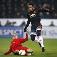 Manchester United's Memphis Depay (right) and FC Midtjylland's Andre Romer vie for the ball during Europa League action in Herning, Denmark, on Thursday. FC Midtjylland won 2-1.   AP