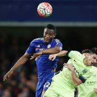 Chelsea's John Obi Mikel (left) and Manchester City's Manuel Garcia Alonso jump for a ball during their F.A Cup match at Stamford Bridge in London on Sunday. Chelsea won 5-1. | AFP-JIJI