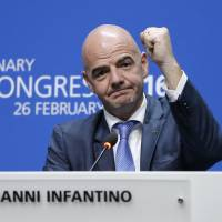 Newly elected FIFA president Gianni Infantino of Switzerland reacts during a news conference after his election at extraordinary FIFA congress in Zurich on Friday. | AP
