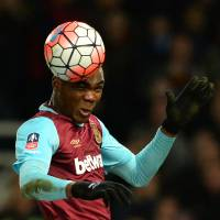 West Ham's Angelo Ogbonna heads the ball during Tuesday's F.A. Cup replay against Liverpool.   AFP-JIJI