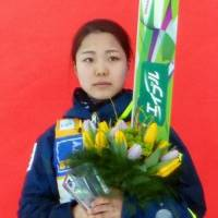 Sara Takanashi stands on the podium after finishing second at a ski jumping World Cup event in Ljubno, Slovenia, on Saturday. | KYODO