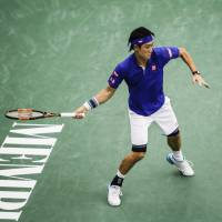 Kei Nishikori prepares to hit a shot during his win over Ryan Harrison at the Memphis Open on Wednesday. | AP