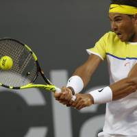 Rafael Nadal plays a shot from Spanish compatriot Nicolas Almagro in their second-round match at the Rio Open on Thursday. Nadal won 6-3, 7-5. | AP