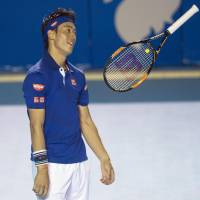 Kei Nishikori tosses his racket in the air during his second-round match with Sam Querrey at the Acapulco Open on Wednesday. Querrey won 6-4, 6-3. | KYODO