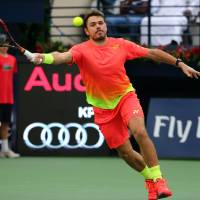 Stan Wawrinka plays a shot from Australia's Nick Kyrgios in their semifinal at the Dubai Tennis Championships on Friday. Wawrinka was leading 6-4, 3-0 when Kyrgios retired with an injury in the second set. | AFP-JIJI