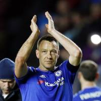 Chelsea captain John Terry applauds the crowd after his team's 5-1 F.A. Cup win over MK Dons on Sunday.   REUTERS
