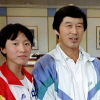 Former Chinese coach Ma Junren (right), seen here with star runner Wang Junxia in an undated photo, has been accused of forcing his runners to use banned drugs. | REUTERS