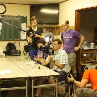 Wesley Julian (right, in the purple T-shirt) works with his crew during a shoot for this 113 Project. | COURTESY OF WESLEY JULIAN