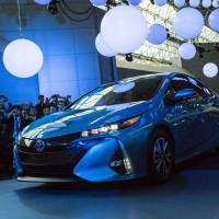The Toyota Motor Corp. Prius Prime plug-in hybrid vehicle is unveiled at the 2016 New York International Auto Show on Wednesday. Nearly 1,000 cars and trucks will be on display at North America's first and largest-attended auto show. | BLOOMBERG