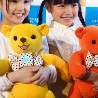 KDDI Corp. unveils a communication tool shaped like a teddy bear Tuesday at an event in Minato Ward, Tokyo. | KYODO