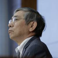 Bank of Japan Gov. Haruhiko Kuroda pauses during a news conference at the central bank's headquarters in Tokyo on Tuesday. | BLOOMBERG
