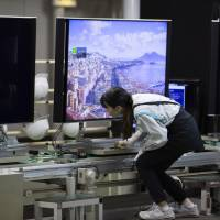 A Sharp Corp. worker inspects a TV at the company's LCD plant in Yaita, Tochigi Prefecture, in November 2015.   BLOOMBERG