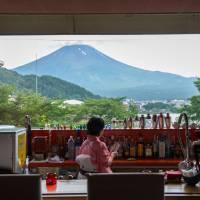 A bar in a hotel near Lake Kawaguchi in Yamanashi Prefecture provides a scenic view of Mount Fuji. | BLOOMBERG