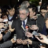Economist Paul Krugman addresses reporters on Tuesday night after meeting with Prime Minister Shinzo Abe at his office in Tokyo. | KYODO