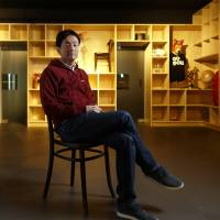 Shintaro Yamada, chief executive officer of Mercari Inc., is pictured in Tokyo on March 11. Mercari, a mobile e-commerce site that matches individual buyers and sellers, this month became the first Japanese startup worth at least $1 billion. | BLOOMBERG