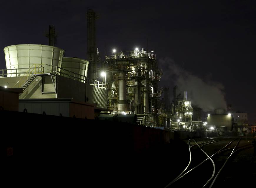 Japan's industrial output falls as weak exports sap demand
