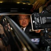 Sharp Corp. President Kozo Takahashi addresses the media as he leaves the company's offices in Tokyo on Feb. 25. | BLOOMBERG
