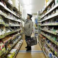 A customer shops at a Sankei Super, K.K. supermarket in Tokyo last month. Household spending dropped for the fifth straight month in January, the government said Tuesday. | BLOOMBERG