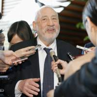 Nobel Prize-winning economist Joseph Stiglitz speaks to reporters Wednesday after meeting with Prime Minister Shinzo Abe and other top government officials in Tokyo. | KYODO