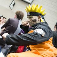 Cosplayers impersonating anime ninja Naruto pose at the London Comicon MCM Expo in 2012. Tencent Holdings, the biggest Internet company in Asia, has bought the rights to more than 300 Japanese anime franchises. | ISTOCK