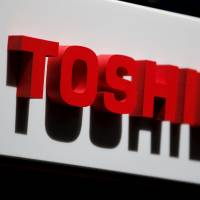 The logo of Toshiba Corp. is seen at the company's news conference venue in Tokyo on May 17, 2012. | REUTERS