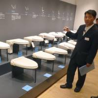 Toto Ltd.'s washlet line of high-tech toilets from its early days to recent models are seen on display at the Toto Museum in Kitakyushu, Fukuoka Prefecture, last August. | KYODO