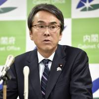 Nobuteru Ishihara, the minister for TPP issues, addresses reporters Tuesday. The Cabinet will step up efforts to explain the pact's benefits. | KYODO