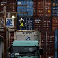 Japan posted its biggest trade surplus in over four years in February, thanks to a strengthening yen and weak oil prices. | REUTERS