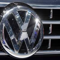The Volkswagen logo is seen in September on a car during the Car Show in Frankfurt, Germany. Volkswagen deleted documents and obstructed justice after the U.S. Environmental Protection Agency accused the company of cheating on emissions tests, a former employee alleges in a lawsuit. | AP