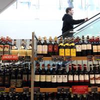 A shelf displaying bottles of wine inside a branch of Marks & Spencer in London on March 2. The European Union maintains Japan's smaller wine bottles would allow Japanese sellers to undercut prices. | BLOOMBERG