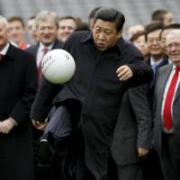Xi Jinping, China's vice president at the time, kicks a soccer ball during a visit to Croke Park in Dublin in February 2012. | REUTERS