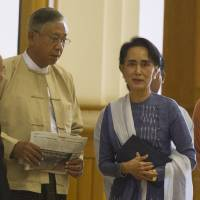Myanmar lower house Speaker Win Myint (second from left), Htin Kyaw (second from right) and pro-democracy leader Aung San Suu Kyi (right) arrive at the lower house in Naypyidaw on Friday. | AFP-JIJI