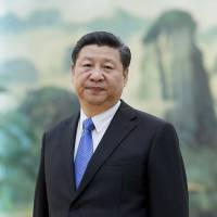 Chinese activist Wen says family held over Xi letter