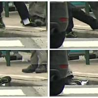 A combination of four images show a closeup detail of a piece of paper falling out of the pants of a suspect apprehended by police in this still image taken from video, in Molenbeek, near Brussels, Friay. Belgian-born Salah Abdeslam, one of the main suspects from November's Paris attacks, was arrested after a shootout with police in Brussels on Friday, the Belgian federal prosecutor's office said. | REUTERS / VTM VIA REUTERS