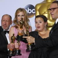 Producers Steve Golin, Blye Pagon Faust, Nicole Rocklin and Michael Sugar of film 'Spotlight' pose with their Oscars at the Academy Awards in Hollywood on Feb. 28. | REUTERS