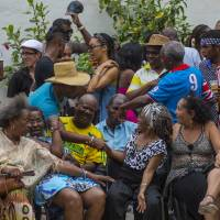 Afro-Cubans take part in a weekly rumba dance gathering in Havana Saturday. Cuba's culture is a blend of African and Spanish influence. | AP