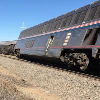 An Amtrak train that derailed in southwest Kansas early Monday, injuring multiple people who were transferred to hospitals in Garden City and Dodge City, may have hit track dislodged by a truck. | OLIVER MORRISON / THE WICHITA EAGLE VIA AP