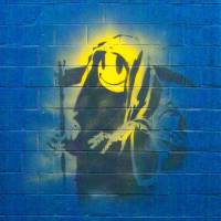 Banksy's 'Grin Reaper With Tag' | SZATER (PUBLIC DOMAIN), VIA WIKIMEDIA COMMONS
