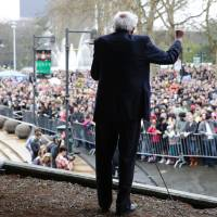 Democratic presidential candidate Bernie Sanders speaks to people waiting to get into his rally at Key Arena on Sunday in Seattle. | AFP-JIJI