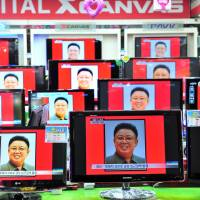 Televisions at an electronics store in Seoul in December 2011 report the death of North Korean leader Kim Jong Il. | BLOOMBERG