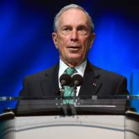 Former New York Mayor Michael Bloomberg speaks during the December C40 cities awards ceremony, in Paris. Bloomberg has decided against mounting a third-party White House bid in 2016. | AP