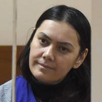 Gulchekhra Bobokulova looks out from the defendant's cage during a hearing at a court in Moscow on Wednesday. | AFP-JIJI