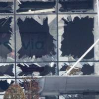 The blown out facade of the terminal is seen at Zaventem Airport, one of the sites of two deadly attacks in Brussels Tuesday. Authorities in Europe have tightened security at airports, on subways, at the borders and on city streets after the attacks Tuesday on the Brussels airport and its subway system. | AP